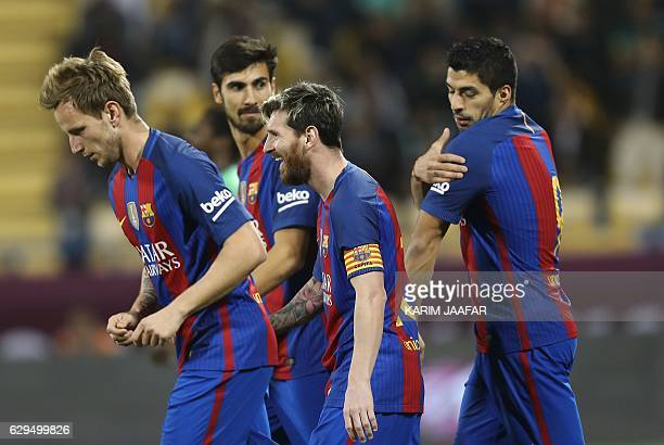 FC Barcelona's Luis Suarez Linonal Messi Ivan Rakitic and André Gomes celebrate after a goal during a friendly football match between FC Barcelona...