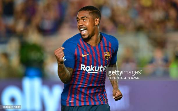 TOPSHOT Barcelona's Malcolm celebrates after scoring the match winning penalty during the International Champions Cup football match between...