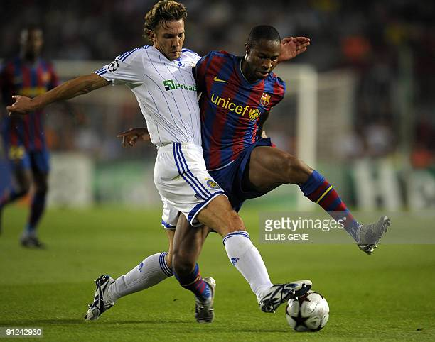 Barcelona's Malian midfielder Seydou Keita vies with Dynamo Kiev's forward Andriy Shevchenko during the UEFA Champions League football match between...