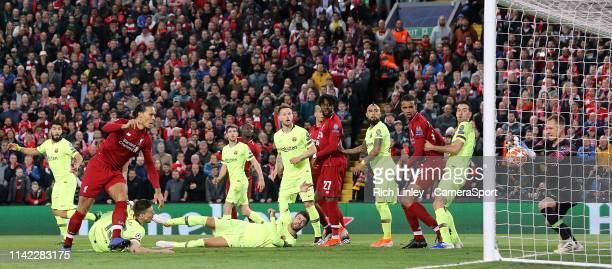 Barcelona's MarcAndre ter Stegen stops a flicked on effort by Liverpool's Virgil van Dijk during the UEFA Champions League Semi Final second leg...
