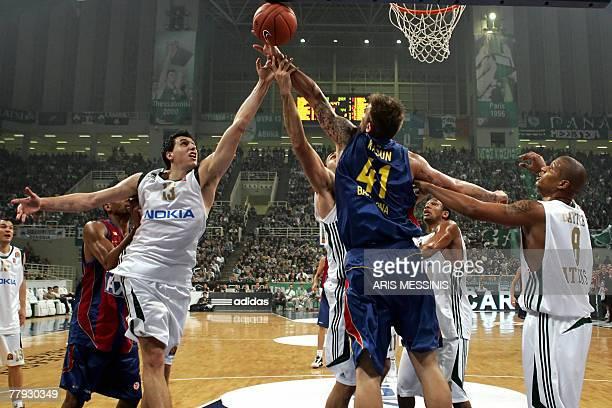 Barcelona's Mario Kasun and Panathinaikos' Dimitris Diamantidis jump for a rebound during their Euroleagaue basketball game in Athens, 15 November...