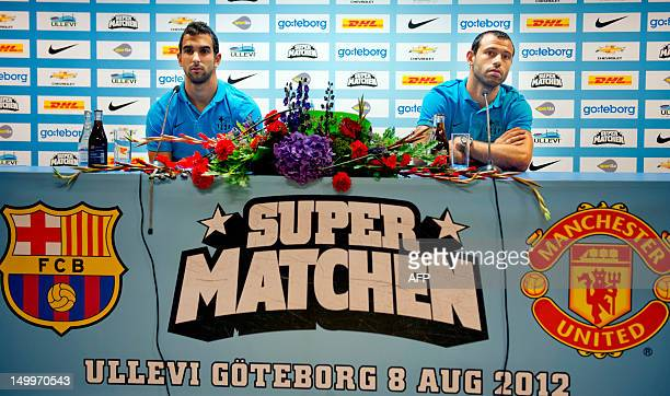 FC Barcelona's Martin Montoya and Javier Mascherano take part in a press conference in Gothenburg on August 8 concerning a friendly match to take...