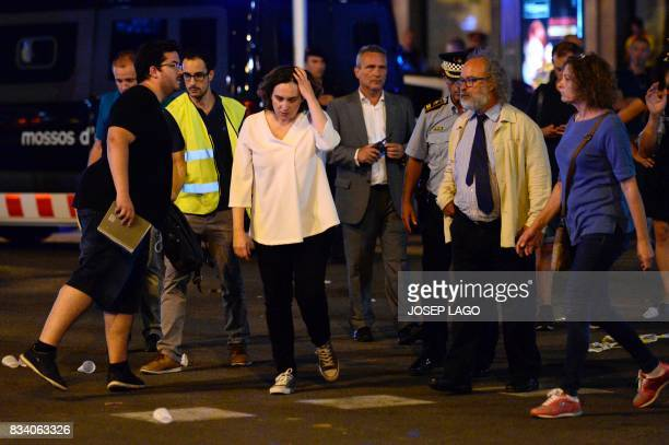 TOPSHOT Barcelona's Mayor Ada Colau and officials arrive on the Rambla boulevard after a van ploughed into the crowd killing at least 13 people and...