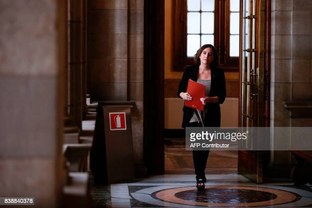 Barcelona's mayor Ada Colau arrives to a press conference for an institutional statement to international media at the City Hall of Barcelona on...