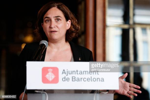 Barcelona's mayor Ada Colau gestures as she gives a press conference during an institutional statement at the City Hall of Barcelona on August 25 on...
