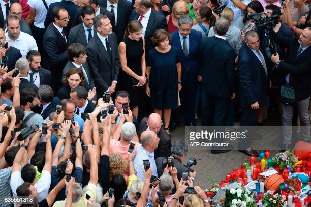 Barcelona's mayor Ada Colau President of Catalonia Carles Puigdemont Spain's King Felipe VI Spain's Queen Letizia and Spanish vicePresident of the...