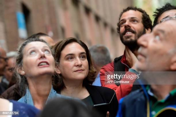 Barcelona's mayor Ada Colau waits outside a polling station in Barcelona on October 01 in a referendum on independence for Catalonia banned by Madrid...