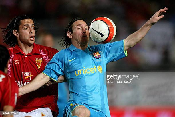 Barcelona´s Messi vies with Murcia´s A Mejia during their Spanish League football match at La Nueva Condomina stadium in Murcia on May 17 2008 AFP...