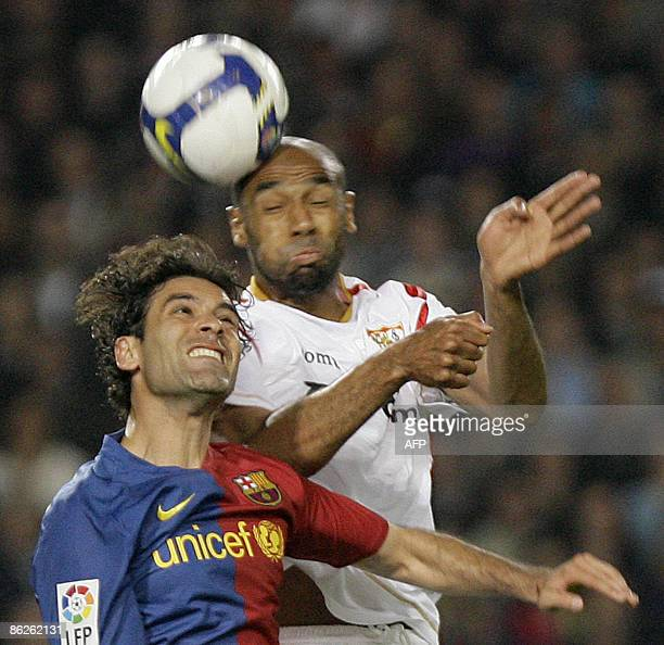 Barcelona's Mexican defender Rafael Marquez fights for the ball with Sevilla's Frederic Kanoute from Mali during the Spanish league football match at...