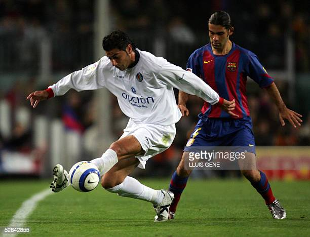 Barcelona's Mexican Rafael Mrquez vies for the ball with Getafe's Riki during their Spanish League football match at the Camp Nou stadium in...