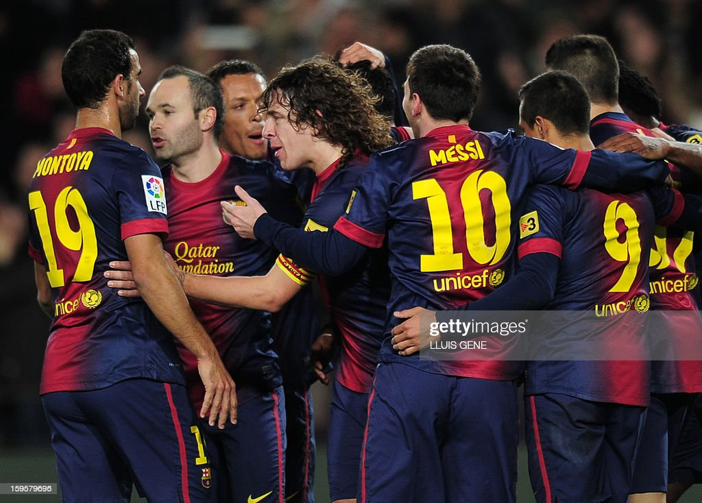 Barcelona's midfielder Andres Iniesta (2ndL) and Barcelona's midfielder and captain Carles Puyol (3rdL) celebrate a goal with teammate during the Spanish Copa del Rey (King's Cup) quarter-final football match FC Barcelona vs Malaga CF at the Camp Nou stadium in Barcelona on January 16, 2013.
