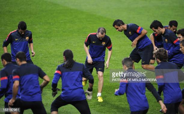 Barcelona's midfielder Andres Iniesta and teammates attend a training session at Luz Stadium in Lisbon on October 1 on the eve of their UEFA...