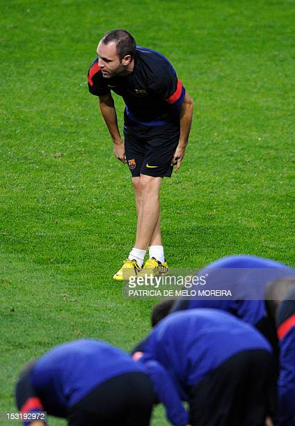 Barcelona's midfielder Andres Iniesta attends a training session at Luz Stadium in Lisbon on October 1 on the eve of their UEFA Champions League...