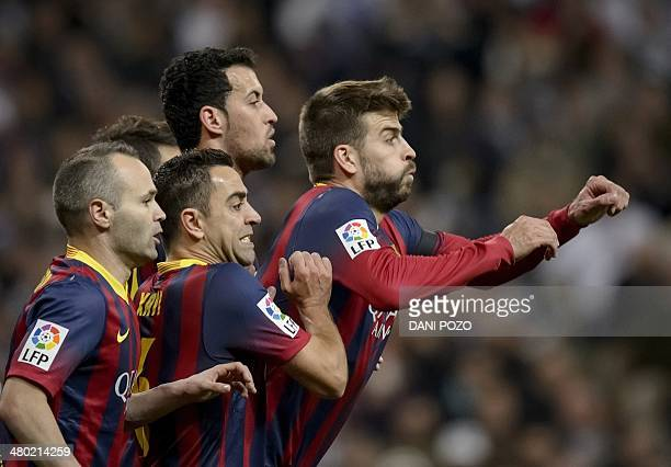 Barcelona's midfielder Andres Iniesta Barcelona's midfielder Xavi Hernandez Barcelona's midfielder Sergio Busquets and Barcelona's defender Gerard...