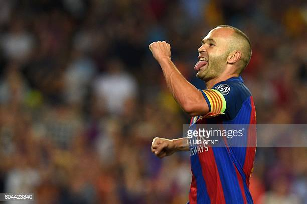 Barcelona's midfielder Andres Iniesta celebrates after scoring a goal during the UEFA Champions League football match FC Barcelona vs Celtic FC at...