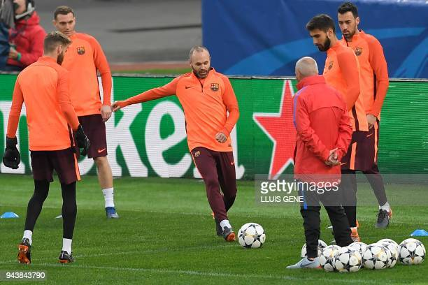 Barcelona's midfielder Andres Iniesta kicks a ball during a training session at the Olympic Stadium in Rome on April 9 2018 on the eve of the UEFA...