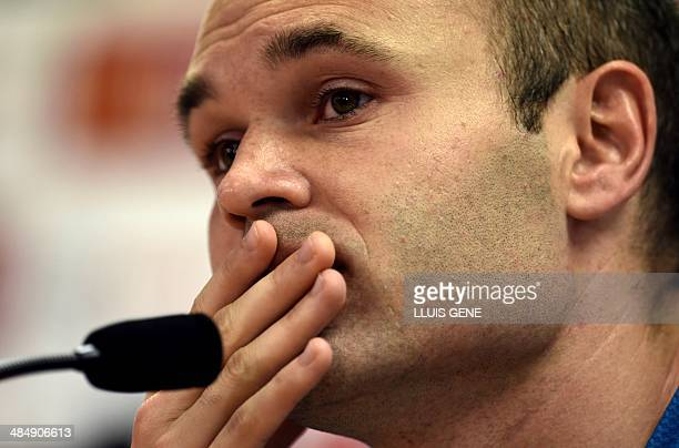 Barcelona's midfielder Andres Iniesta reacts during a press conference at the Sports Center FC Barcelona Joan Gamper in Sant Joan Despi, near...