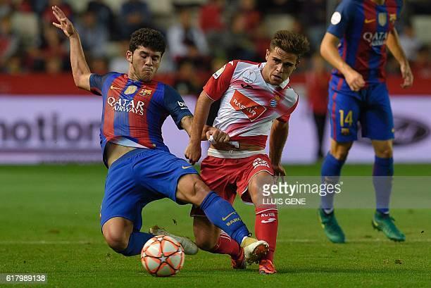 Barcelona's midfielder Carles Alena vies with Espanyol's forward Oscar Melendo during the Catalonia Super Copa football match between FC Barcelona...