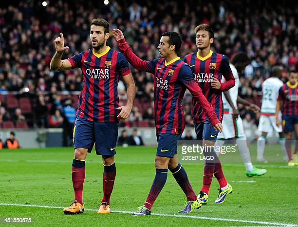 Barcelona's midfielder Cesc Fabregas celebrates with Barcelona's forward Pedro Rodriguez after scoring during the Spanish league football match FC...