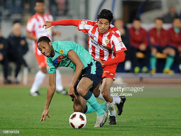 Barcelona's midfielder Corona vies with Almeria's Colombian midfielder Fabian Vargas during the Spanish King's Cup semifinal secondleg football match...