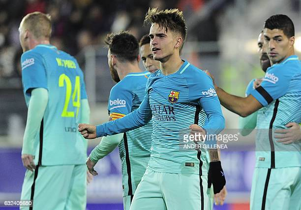 Barcelona's midfielder Denis Suarez celebrates after scoring the opener during the Spanish league football match SD Eibar vs FC Barcelona at the...