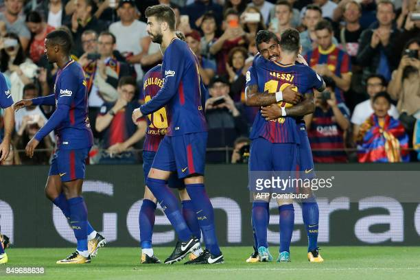 Barcelona's midfielder from Brazil Paulinho celebrates with Barcelona's forward from Argentina Lionel Messi after scoring during the Spanish league...