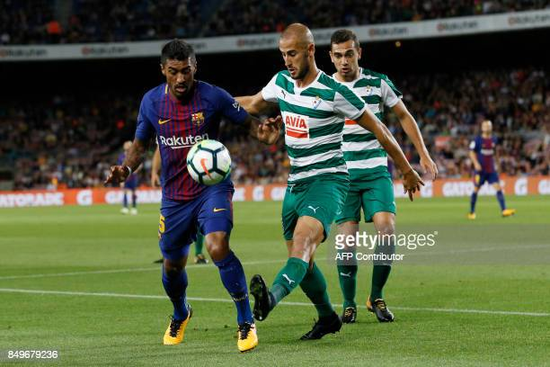 Barcelona's midfielder from Brazil Paulinho vies with Eibar's midfielder from Argentina Gonzalo Escalante during the Spanish league football match FC...