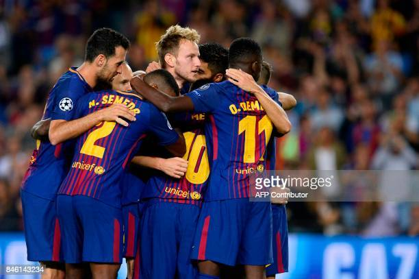 Barcelona's midfielder from Croatia Ivan Rakitic celebrates with teammates after scoring during the UEFA Champions League Group D football match FC...