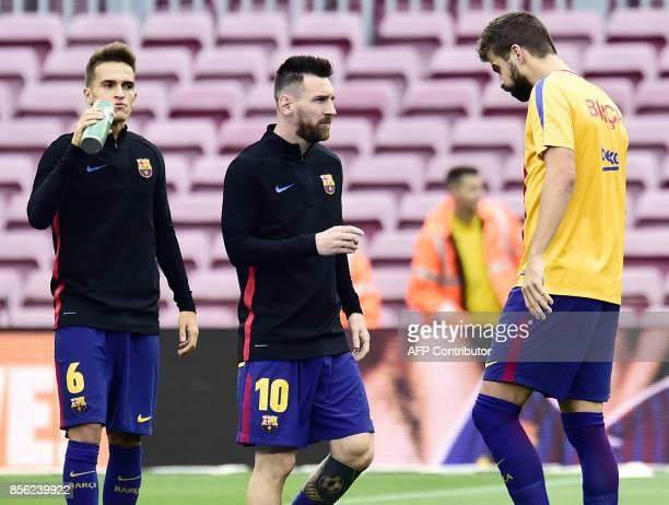 Barcelona's midfielder from Spain Denis Suarez Barcelona's forward from Argentina Lionel Messi and Barcelona's defender from Spain Gerard Pique warm...