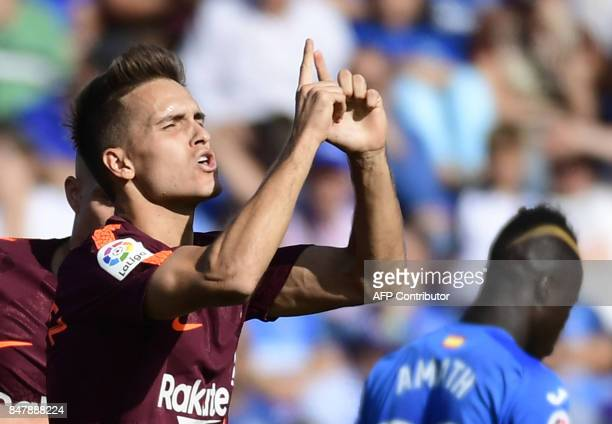 Barcelona's midfielder from Spain Denis Suarez celebrates a goal during the Spanish league football match Getafe CF vs FC Barcelona at the Col...