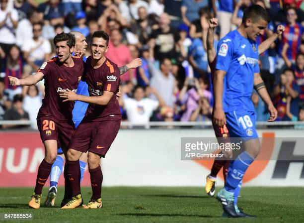 Barcelona's midfielder from Spain Denis Suarez celebrates a goal with Barcelona's midfielder from Spain Sergi Roberto during the Spanish league...