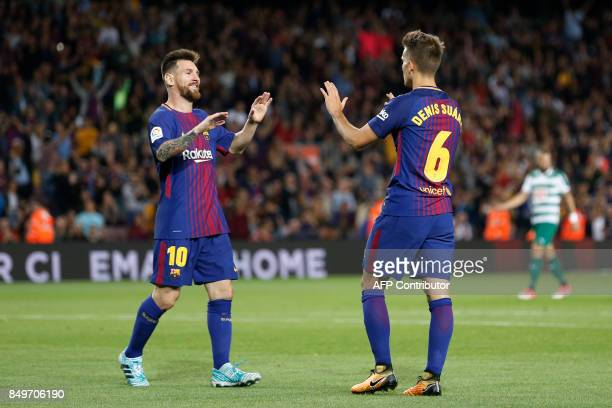 TOPSHOT Barcelona's midfielder from Spain Denis Suarez celebrates with Barcelona's forward from Argentina Lionel Messi after scoring during the...