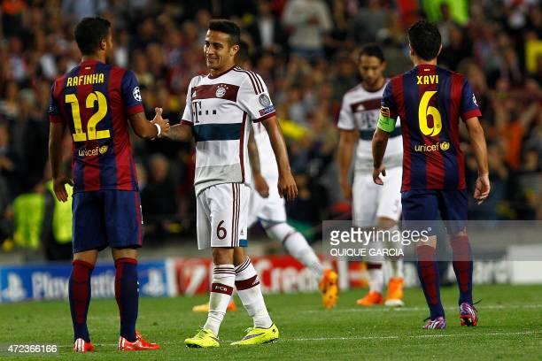 Barcelona's midfielder Rafinha shakes hands with his brother Bayern Munich's Spanish midfielder Thiago Alcantara during the UEFA Champions League...
