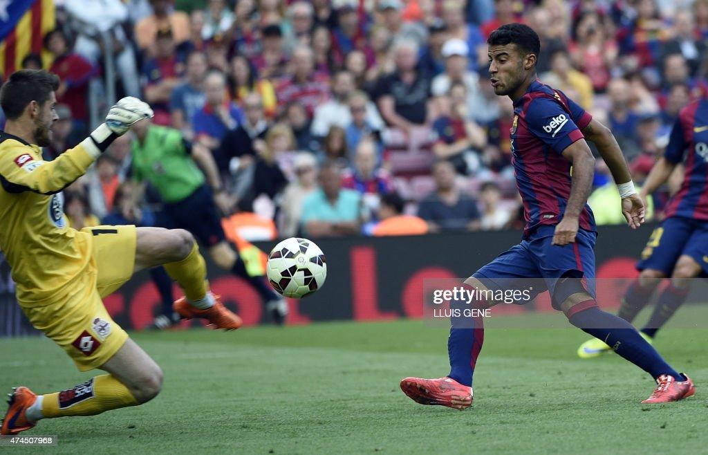 Barcelona's midfielder Rafinha (R) shoots against Deportivo's goalkeeper Fabri (L) during the Spanish league football match FC Barcelona vs RC Deportivo La Coruna at the Camp Nou stadium in Barcelona on May 23, 2015.