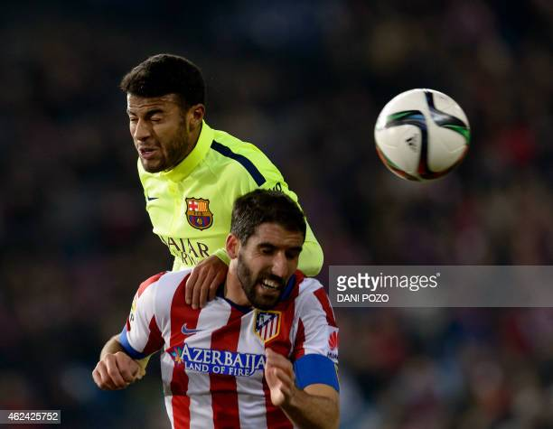 Barcelona's midfielder Rafinha vies with Atletico Madrid's midfielder Raul Garcia during the Spanish Copa del Rey quarter final second leg football...