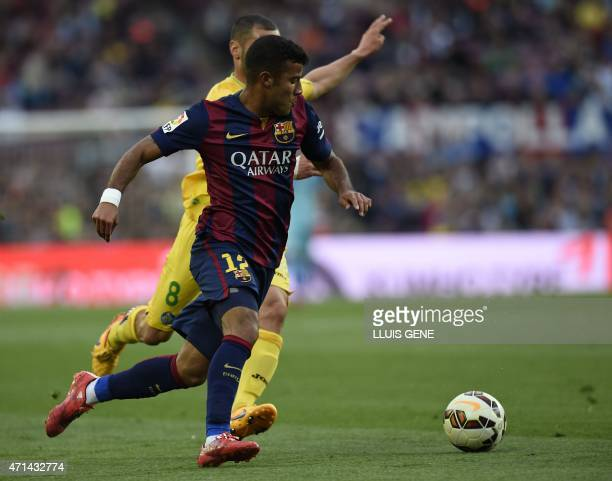 Barcelona's midfielder Rafinha vies with Getafe's Algerian midfielder Medhi Lacen during the Spanish league football match FC Barcelona vs Getafe at...