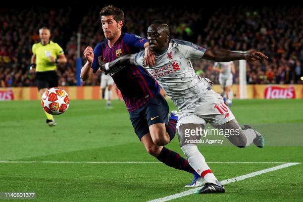Barcelona's midfielder Sergi Roberto and Liverpool's Senegalese forward Sadio Mane vies with during semi finals of UEFA Champions League football...