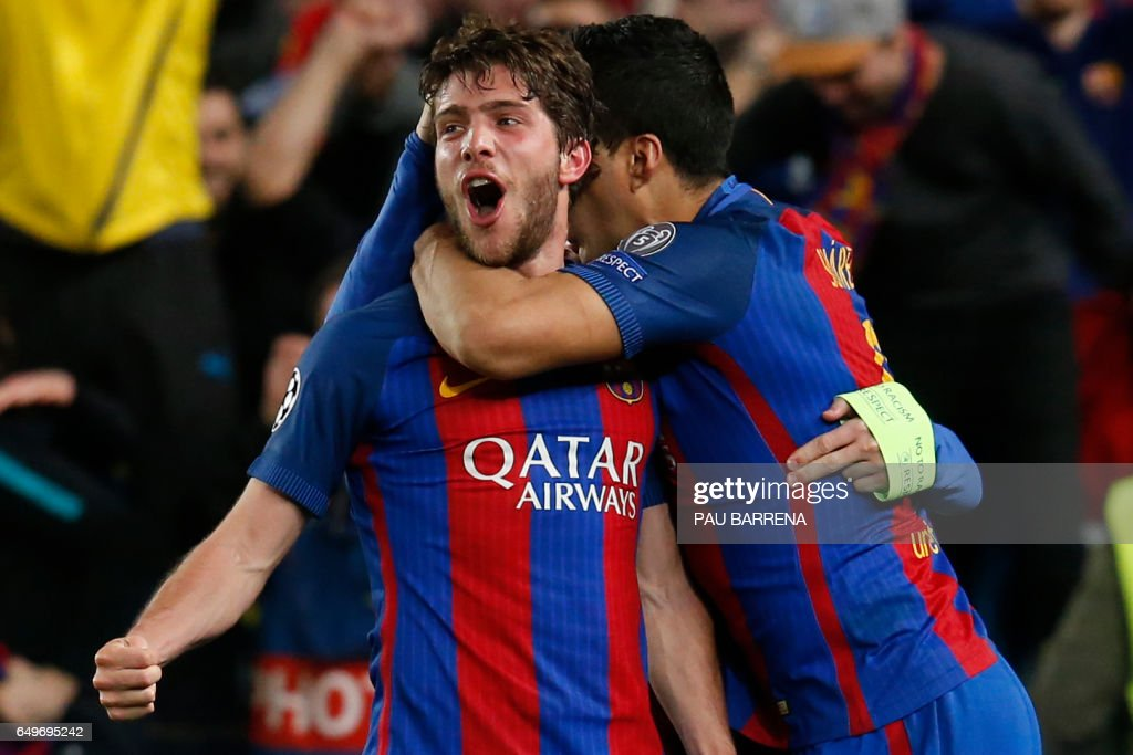 TOPSHOT - Barcelona's midfielder Sergi Roberto (L) celebrates after scoring a goal during the UEFA Champions League round of 16 second leg football match FC Barcelona vs Paris Saint-Germain FC at the Camp Nou stadium in Barcelona on March 8, 2017. /