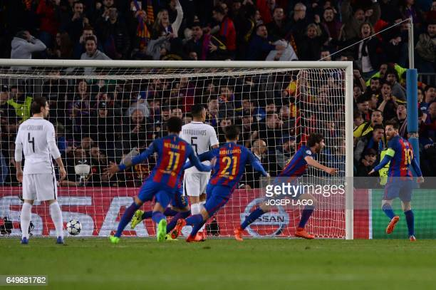 Barcelona's midfielder Sergi Roberto celebrates their victory goal during the UEFA Champions League round of 16 second leg football match FC...