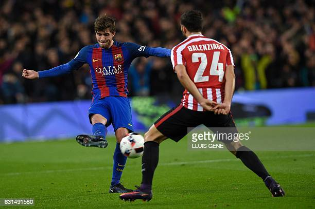 Barcelona's midfielder Sergi Roberto vies with Athletic Bilbao's defender Mikel Balenciaga during the Spanish Copa del Rey round of 16 second leg...