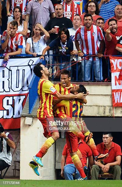 Barcelona's midfielder Sergio Busquets and Barcelona's Brazilian defender Dani Alves congratulate Barcelona's Brazilian forward Neymar da Silva...