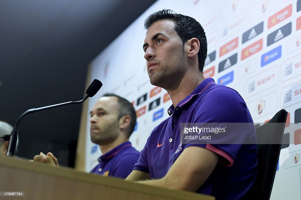 Barcelona's midfielder Sergio Busquets (R) and Barcelona's midfielder Andres Iniesta give a press conference after a training session on the eve of the Spanish King's Cup final football match FC Barcelona vs Athletic Bilbao at the Sports Center FC Barcelona Joan Gamper in Sant Joan Despi, near Barcelona on May 29, 2015.