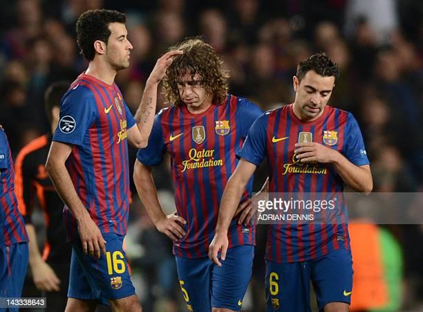 Barcelona's midfielder Sergio Busquets Barcelona's captain Carles Puyol and Barcelona's midfielder Xavi Hernandez react after loosing the UEFA...