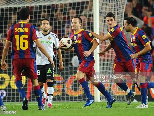 Barcelona's midfielder Sergio Busquets Barcelona's midfielder Andres Iniesta Barcelona's forward David Villa and Barcelona's midfielder Xavi...