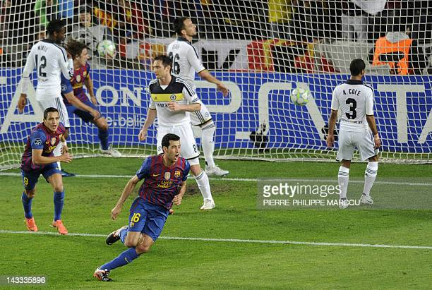 Barcelona's midfielder Sergio Busquets celebrates scoring against Chelsea during the UEFA Champions League second leg semifinal football match...