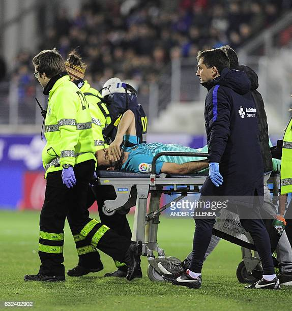 Barcelona's midfielder Sergio Busquets is stretched out during the Spanish league football match SD Eibar vs FC Barcelona at the Ipurua stadium in...