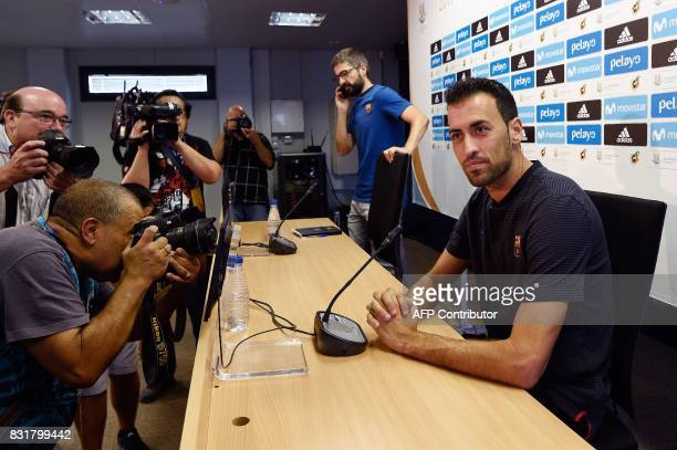 Barcelona's midfielder Sergio Busquets sits before giving a press conference at the Sports Center FC Barcelona Joan Gamper in Sant Joan Despi near...