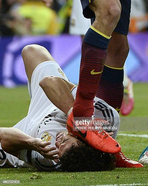 Barcelona's midfielder Sergio Busquets steps on the head of Real Madrid's Portuguese defender Pepe during the Spanish league Clasico football match...
