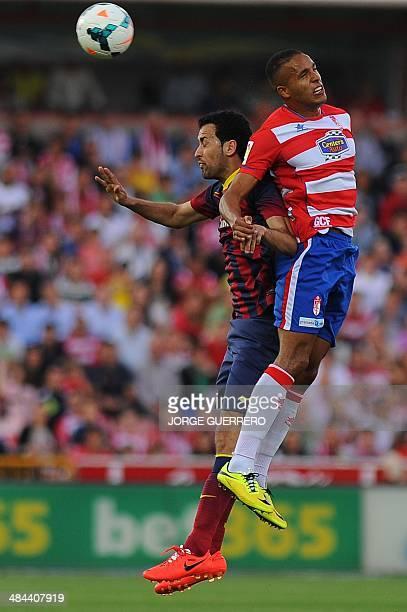 Barcelona's midfielder Sergio Busquets vies with Granada's Moroccan forward Youssef ElArabi during the Spanish league football match Granada CF vs FC...