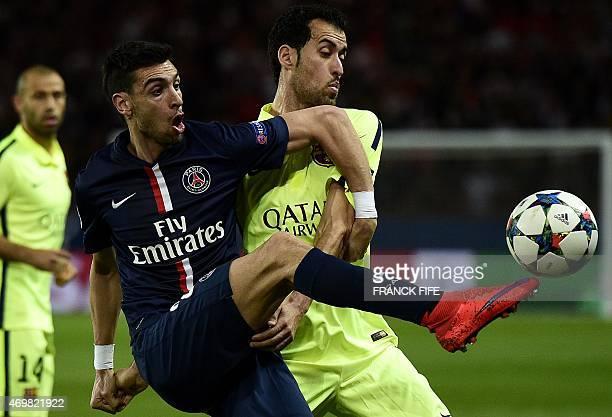 Barcelona's midfielder Sergio Busquets vies with Paris SaintGermain's Argentinian midfielder Javier pastore during the UEFA Champions league...